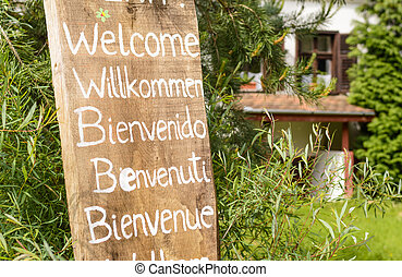 wooden welcoming sign