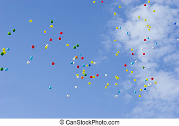 Balloons in sky - many multicolored balloons flying in blue...