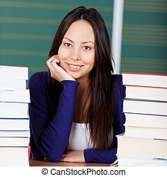 happy female student - smiling young woman with chin on hand...