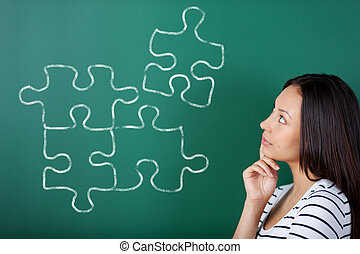 young woman completing puzzle - young woman in school...