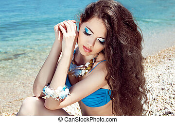 Healthy Long Hair Beautiful girl on the beach posing near...
