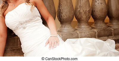 Bridal Gown - A beautiful bride reclines on her wedding day