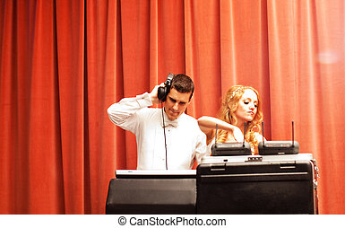 Newlywed Couple DJing - A newlywed couple enjoy DJing music...