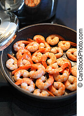 Frying shrimp - Photo of shrimp being fried in butter on a...
