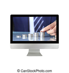 Businessman hand put coins in computer monitor