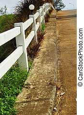White fence with road