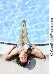 Relaxing at the pool - Beautiful attractive woman laying...
