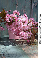 Beautiful japanes cherry flowers in the vase, vintage style
