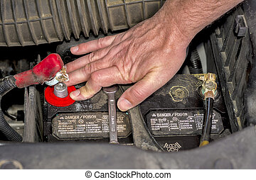Automotive repair installing a battery