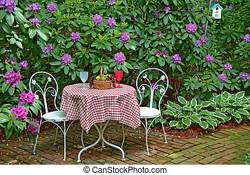 old table and chairs in azaleas - Old-fashioned table and...