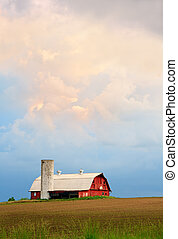 Barn and Evening Sky - A dramatic sunset sky hangs over a...