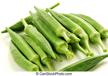 Okra is steamed and eaten as a vegetable or used in...