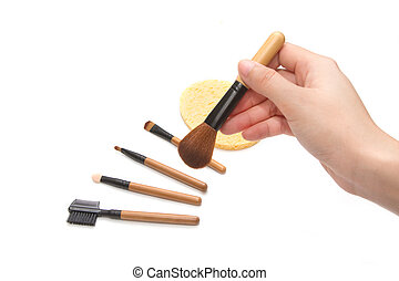 hand with set of  makeup brushes