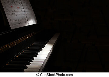 Piano keyboard in low light