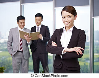asian business people - portrait of a young asian...