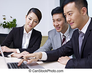asian business people - a team of asian business people...