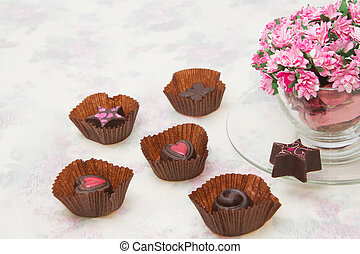 Chocolate Truffles with bouquet of pink roses in the coffee...