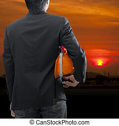 Engineer or architect looking ahead at sunset