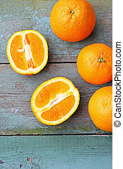 Fresh oranges on the rustic table