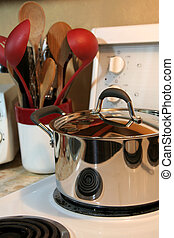 Stovetop Cooking - Cooking equipment sitting on the stove...