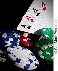 Poker close-up - Four aces on a green poker table