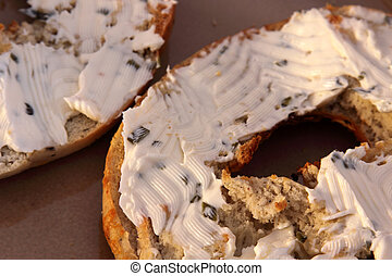 Closeup of Bagel and Cream Cheese - A toasted bagel with...
