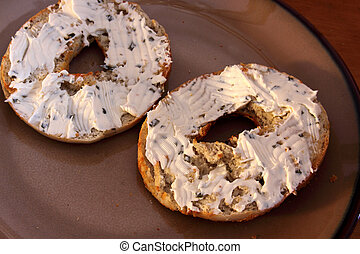 Bagel with Cream Cheese Spread - A toasted bagel with cream...