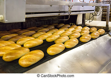 Production of bread in factory - Baked Breads on production...