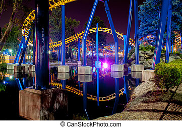 A rollercoaster at a theme park in USA at night