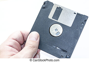 Diskette - Hand is holding a diskette