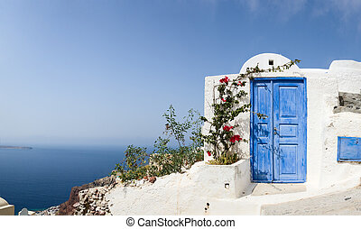 Door to nowhere. One of symbols of Greek island Santorini.