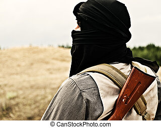 Muslim rebel with automatic rifle and machine-gun belt