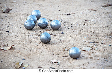 Bocce balls in the field of land