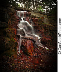 Timed Exposure Cascading Waterfall - The white waters of a...