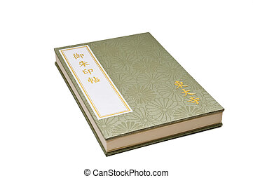Japanese book - Green paper with Japanese writing on a white...