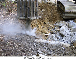 Breaking Rocks - Hydraulic hammer in action, showing...
