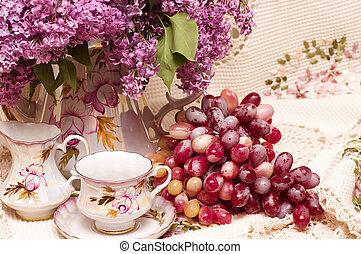 Vintage teacup with spring flowers lilac