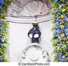Manneken Pis in Brussels - Manneken Pis dressed in suit and...