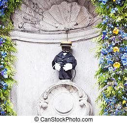Manneken Pis in Brussels - Manneken Pis dressed in suit and...