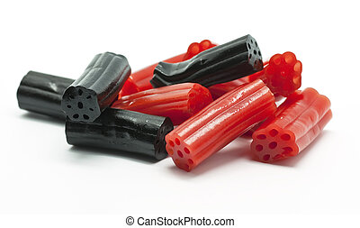 Licorice - Red and black licorice on white background