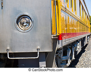 Closeup Side View of an Old-Fashioned Passenger Train