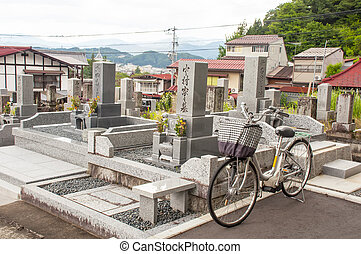 Japanese cemetery - Bike parked in a Japanese cemetery