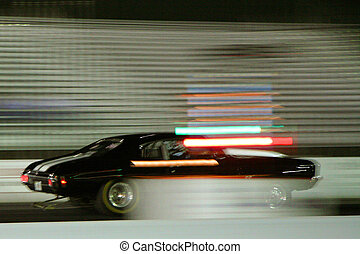 Fast car racing - Side view of black car racing with...