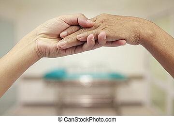 Holding senior hand