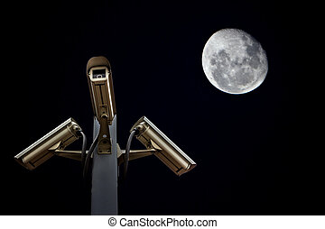 outdoor security cctv cameras against night sky and moon