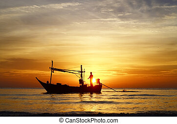 Fisherman at sunrise - Silhouette of fisherman on boat in...