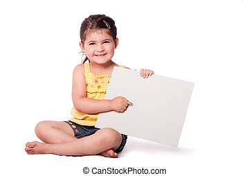 Happy girl sitting pointing at whiteboard - Cute happy...