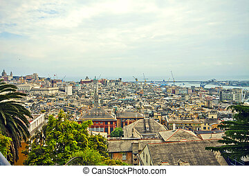 Genoa - Italy, panorama of the old town and harbor -...
