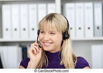 cheerful businesswoman using headset
