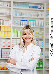 Confident Female Pharmacist With Arms Crossed